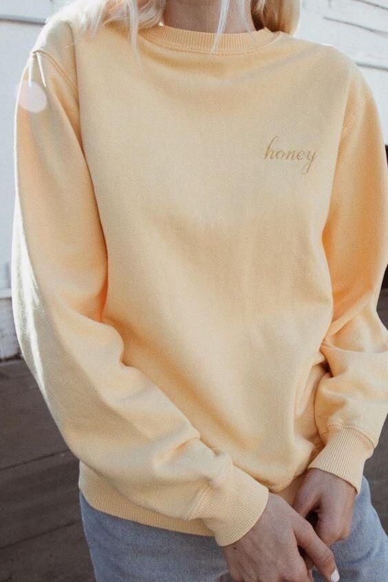 "yellow sweater with ""honey"" embroidery"