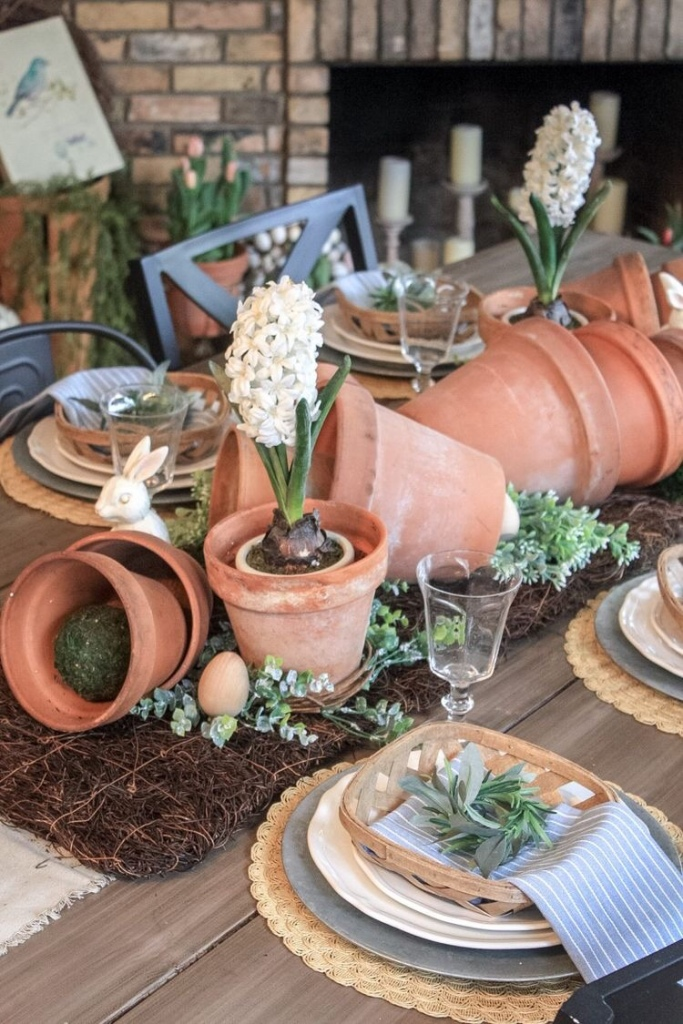 easter and spring table scape with terracotta pots