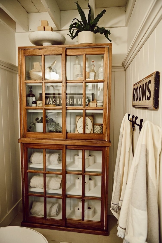 Vintage bookcase with sliding glass panes