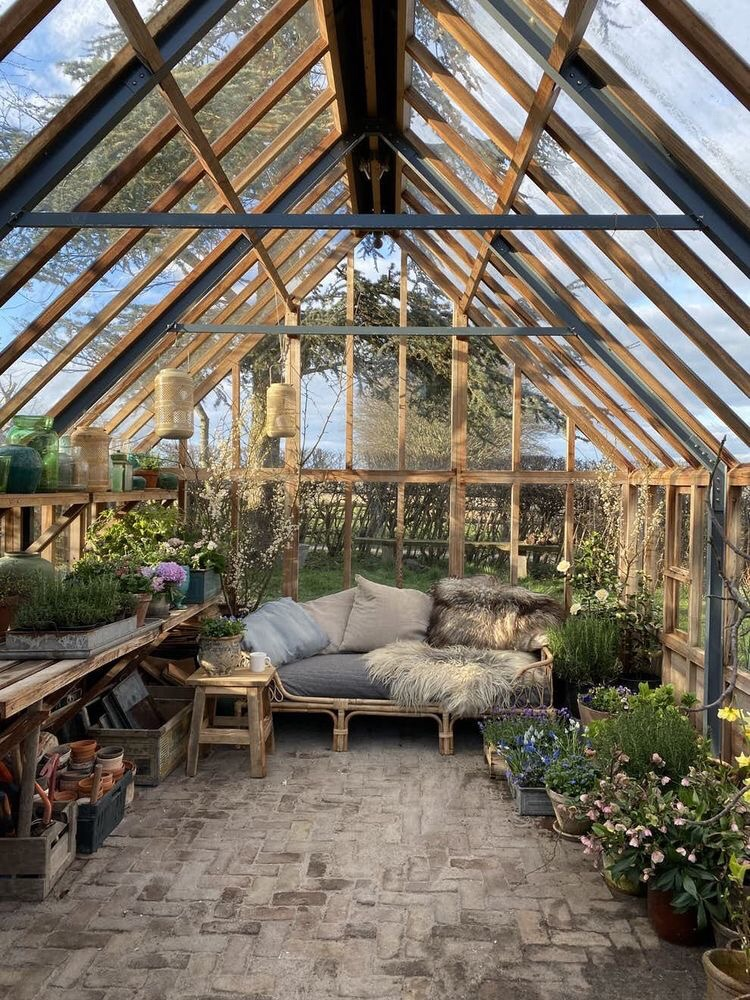 Greenhouse with cozy rattan daybed