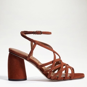 A versatile slender strappy sandal with a block heel is something that every closet needs. Daffodil Heel Sandal Closure: Ankle strap buckle Toe: Open Heel Height: 3.2 inches Material: Suede and croco printed leather