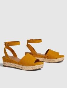 This wedge sandal's espadrille platform is totally made to be shown off. Pair it with a flowy maxi dress or comfy tee-and-capris look for the perfect finishing touch. Faux suede. Open toe. Adjustable buckle closure at ankle.
