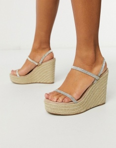 Wedges by Steve Madden Coming soon to your Saved Items Slip-on style Rhinestone-embellished straps Open toe Woven midsole High heel