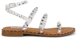 Steve Madden Travel Sandal in Tan. - size 10 (also in 9.5) Studded PVC upper with man made sole. Ankle strap with buckle closure. Imported.