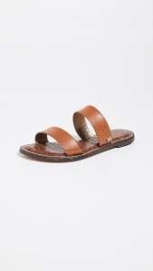 Leather: CowhideGold-tone logo emblemCroc embossed sole liningSlide sandalsOpen toeMan-made soleImported, ChinaThis item cannot be gift-boxed
